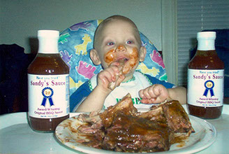 Photo of baby eating Sandy's BBQ Sauce